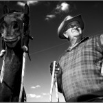 Gordon Sowden, farmhand, and horse at Towarra Cattle Station, Australia